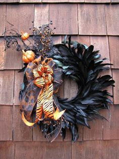 I love Halloween - - this wreath is awesome but it doesnt stand a chance in a house with two cats.