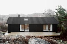 Black exterior. Takes a small simple place to a sleek modern statement.