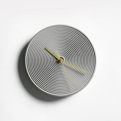 A simple and yet striking design, this contemporary concrete wall clock features brass hands and a circular pattern on the clock face, representing the trail of time passing away. Concrete Ceiling, Concrete Floors, Wall Clock Brass, Wall Clocks, Modern Clock, Circular Pattern, First Home, Time Passing, Contemporary