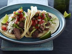 Tacos Carne Asada : Marinated flank steak plus pico de gallo, guacamole and queso fresco complete Tyler's five star tacos. via Food Network