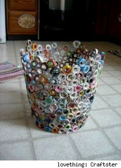 Recycle old magazines into a colourful garbage can