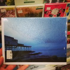 THE classic image of starlings over Aberystwyth pier. Gorgeous. Greetings card for sale at Aberystwyth Arts Centre Craft & Design Shop.