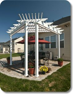 This beautiful by is ideal for creating a cozy area on your deck, patio, or in a secluded corner of your yard. Diy Pergola Kits, Garage Pergola, Corner Pergola, Wooden Pergola, Pergola Designs, Pergola Patio, Backyard Patio, Vinyl Pergola, Pergola Ideas