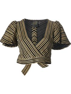 Black and gold-tone chevron stripe skirt suit from Biba featuring a jacket with a wrap style front, a tie fastening, short puff sleeves and a cropped length. The skirt features a high waist and loose pleat detailing.