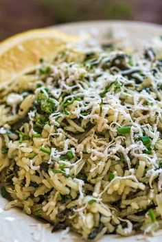 This simple, delicious, and authentic Spanakorizo (Greek Spinach Rice) makes a filling vegetarian meal or a side dish. Fresh dill, chives, and lemon juice give it an extraordinary flavor and aroma.COM with feta and bread Greek Dishes, Rice Dishes, Vegetarian Recipes, Cooking Recipes, Healthy Recipes, Ham Recipes, Flour Recipes, Turkey Recipes, Chicken Recipes