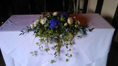 A beautiful table display with rich blues and delicate creams, lovely for weddings or functions.