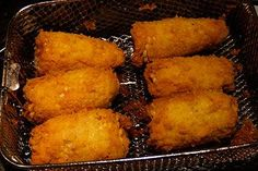 Deep Fried Corn on the Cob tastes sort of like grilled corn, with a yummy cornmeal crust on it. Nice with a wedge of lime to squeeze on it.