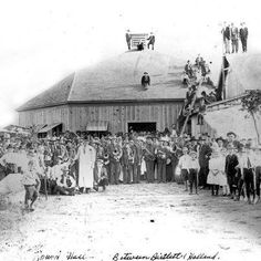 Texas Dance Hall Preservation, Inc.  Early 1900's gathering at Round Hall, which was located between Holland and Bartlett, Texas. I'm from the area and don't believe the building exists anymore. If you look at it in full screen mode you can see the band (probably polka) etc... I'm guessing this was on the day the hall opened, which was no doubt cause for celebration.