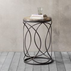Kimba Side Table  A stylish and practical side table with a gold hammered table top and clean cut metal legs in a curved spiral design, adding a cool and industrial look to your interior.