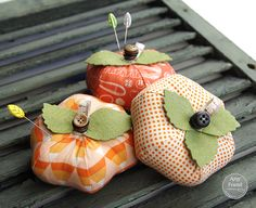 Amy Friend's adorable Pumpkin Pincushions. Look at those stacked buttons to form the stem: so clever!