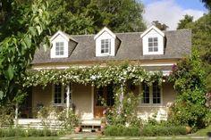 zeer chique tuinhuis, mooi met de rozenrembler Door Merryfish