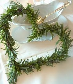 Heart shaped rosemary wreath. Tiny ones of these would be cute on place settings at holiday dinners