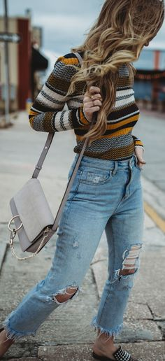 Spring retro outfit styled with striped turtleneck, distressed high waisted jeans, and pearl slide mules #springoutfit #rertooutfit #mules
