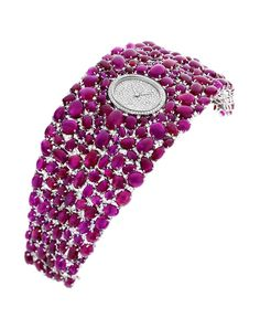 """Showered with 214 Burmese cabochon-cut rubies, together with 419 diamonds used as accents in-between, the DELANEAU """"Grace"""" rubies watch bursts with rich colour."""
