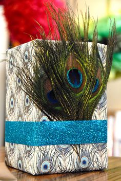 love the feathers and glitter tape(.99) from craft store to wrap presents..i would use the solid peacock feather colors, too..  ~older and wisor