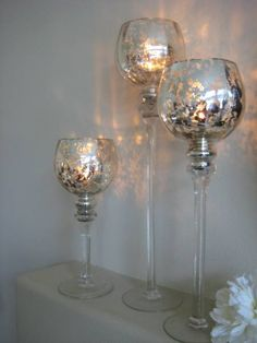 Love these.  Mercury glass trio.  Multiples on a table create a super dramatic look!