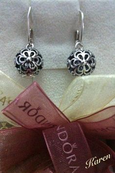 "by Karen Rosario  openworks flowers set as earrings with the ""barrels"" :)"