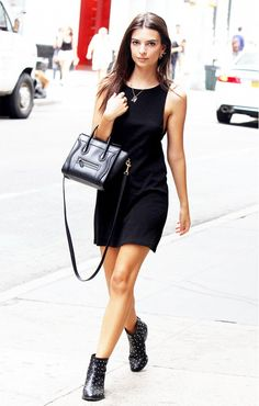Emily Ratajkowski wears a black mini tank dress, layered necklaces, studded ankle boots, and a mini Céline tote