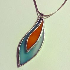 Handcrafted Turquoise and Tangerine Layered Stained Glass Necklace - Cool Glass Art Designs Stained Glass Christmas, Stained Glass Projects, Stained Glass Patterns, Fused Glass Jewelry, Glass Earrings, Glass Pendants, Soldering Jewelry, Tiffany Glass, Glass Ornaments