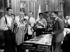 L-R: Charlie Barnet, Tommy Dorsey, Benny Goodman, Louis Armstrong, and Lionel Hampton.