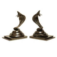 """Fine wrought iron cobra bookends on a stepped rectangular base with a rich dark brown patina by Edgar Brandt (1875-1968).  Signed: """"E. BRANDT"""". France circa 1925"""