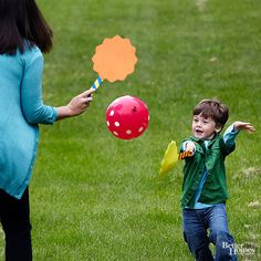 Little ones will enjoy this fun twist on badminton. Use homemade foam rackets to keep the colorful balloon off the ground. 1. Cover paint stirrers or rulers with tape. 2. Cut crafts foam into desired shapes -- ours are about 8 inches across. 3. Tape foam circles to handles. 4. Blow up a balloon and go!