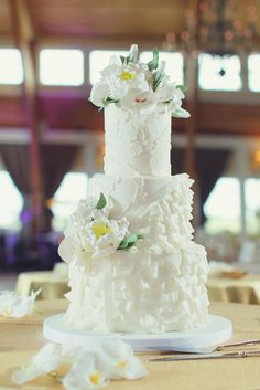 Textured Three-Tier Wedding Cake | Vanessa Joy Photography https://www.theknot.com/marketplace/vanessa-joy-photography-freehold-nj-436991 | Rob Adams Films https://www.theknot.com/marketplace/rob-adams-films-freehold-nj-372785 | The Cake Studio Of Ocean City https://www.theknot.com/marketplace/the-cake-studio-of-ocean-city-ocean-city-nj-211181