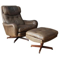 Danish Modern leather lounge chair and ottoman by IB Kofod Larsen. The chair can be reclined with a lever on the side and the ottoman is also adjustable. Made from rosewood and brown leather    Price  $2,200