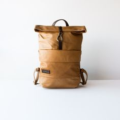 Lowell Unisex Tan Leather Luxury Backpak - Chic & Basta. The Davidson bag is an unisex backpack with lots of storage to organize your needs. It is our ultimate luxury backpack made with 100% full grain leather to transport all of your essentiels.