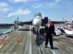 David Friede, Harry Krantz COO, stands in front of F-18 Super Hornet at the change-of-command ceremony for the Commander, U.S. Third Fleet