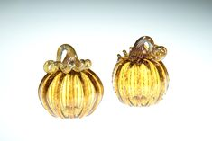 Amber Glass Pumpkin with Gold Stem, This piece is one of our smaller pumpkins, they range in size from 3-4 inches. Some of the pumpkins we roll through a little frit on the surface, frit is small chips of glass that give the piece a little extra sparkle. This is a great fall wedding gift, Fall decor, gift for mom, gift for a friend, gift for dad, fall wedding gift, or anniversary gift. #falldecoration #glasspumpkin #halloweendecor #giftformom #thanksgivingdecoration #blownglass #artglass Small Pumpkins, Glass Pumpkins, Thanksgiving Decorations, Halloween Decorations, Fall Wedding, Wedding Gifts, Corning Museum Of Glass, Fall Gifts, Amber Glass