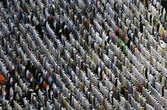 Pilgrims pray outside the Grand mosque in Mecca, on October 22, 2012. The annual Islamic pilgrimage draws three million visitors each year, making it the largest yearly gathering of people in the world