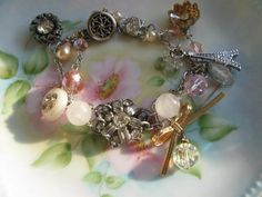 Buttons and Bows.vintage old ooak rhinestone bracelet. $48.00, via Etsy.