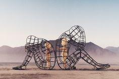 Burning Man wire sculpture with baby dolls in Black Rock Desert