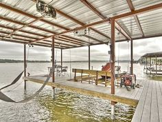 Covered dock with boat lift and double jet ski lift.