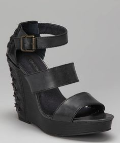 Take a look at this Black Hara Wedge by Calvin Klein on #zulily today! $34.99, regular 99.99.  PRODUCT DESCRIPTION: Elegant in front and edgy in the back, these chic studded leather wedges flaunt wide, flexible straps with a soft denim lining and adjustable buckle, so sporting rockstar-worthy steps is as comfy as it is classy.   5'' heel with 1.25'' platform Buckle closure Leather upper Man-made sole Imported