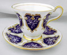 Tuscan Tea cup and saucer art deco purple panel roses