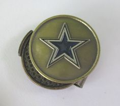 Dallas Cowboys Hat Clip & Golf Ball Marker by Waggle Pro Shop. $9.95. Magnetic golf ball marker sits securly on the hat clip. Clip fits hats, caps or belts and is always visible. Show your Cowboys pride with an NFL golf ball marker. Great gift idea for golfers. Never Lose Your Golf Ball Marker Again!. Show your team pride and spirit while you golf by wearing a Dallas Cowboys hat clip with a magnetic golf ball marker. Forget about fumbling through your pockets for ...