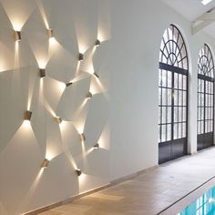 create light art. alternative to feature wall.plays like water reflection. maybe on middle wall in living room top floor. Topix LED Wall Light. Delta Light.
