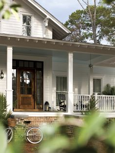 Beautiful southern porch, lanterns, brick steps, blue beadboard ceiling...