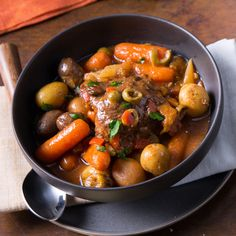 Tender chicken thighs flavored with a fragrant spice paste and made in the slow cooker with carrots, potatoes and dried fruit