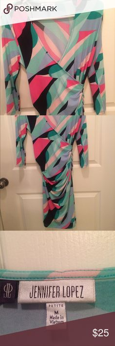 Jennifer Lopez dress Jennifer Lopez dress, new with out tags. Never worn. Doesn't fit me. Jennifer Lopez Dresses Long Sleeve