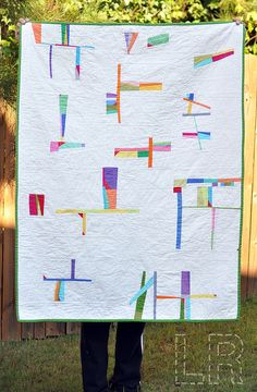 awesome quilt by LRstitched.      Looks like gymnastic figures to me.