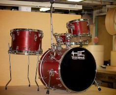 Compact on Broadway--Shannon's compact kit just the way he wanted: red finish, accessory arm, cymbal arm, beer tap strainer, and the snare on a stand.  7x10, 10x14, 16x18, 4½x14; plied maple; semi-gloss wax.  To see more pix, and search our entire TreeHouse archive for your favorite specs, visit our photo gallery:http://www.flickr.com/photos/treehousedrums/collections/