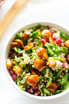 Pomegranate Quinoa Salad with Candied Almonds, Mixed Greens, Goat Cheese and Pomegranate Balsamic Vinaigrette