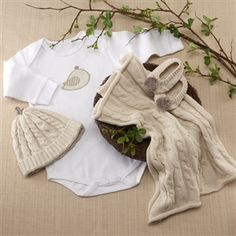 """http://www.gotobaby.com/ –  Feel the warm, wonderful thoughts of nestling and nurturing with the beautiful """"Feathering the Nest"""" layette gift set offered by Go To Baby."""