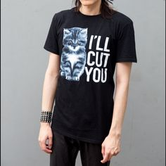 "Cute Kitty Graphic T-shirt UNISEX Short Sleeve M Graphic tee with a cute kitty and ""I'll Cut You"" printed on it. Young men's size medium. Fits a bit smaller as I'm normally an XS/S. Item is new and just worn to model.    ✅✅Will Drop Price to $20 for reduced shipping!✅✅  #Tshirt #graphic #cat #kitty #cute #attitude #adorable #goth Gildan Tops Tees - Short Sleeve"