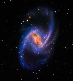 NGC 1365, also known as the Great Barred Spiral Galaxy, is about 56 million light-years away in the constellation Fornax. The NGC 1365 galaxy is 200,000 light-years across and about twice the size of the Milky Way, making it one of the largest galaxies known to astronomers.