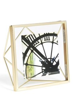 Free shipping and returns on UMBRA 'Prisma' Photo Frame at Nordstrom.com. A geometric wire frame lets you display your favorite photos in elegant, contemporary style.