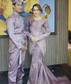 Baju songket couple - Most bridal couples choose to wear traditional Malay attire on their wedding day. Clothes made of songket – a hand-woven fabric embroidered with golden threads – are a popular choice